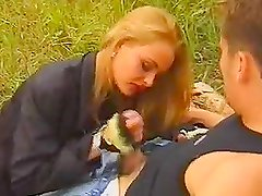 Horny chick gives hot passionate blowjob on firewoods