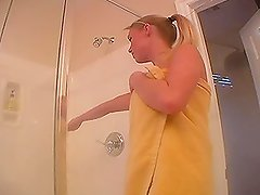 Watch this video to see this busty blonde masturbating in the shower