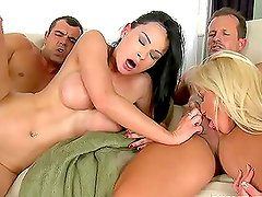 Two couples fucking together in the same room switching partners