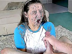 Pretty brown-haired chick gets her face covered in cum