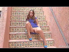 Graceful Sofia is toying her pussy on stairs in the street