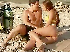 Claudia Rossi blowjobs and gets fucked on a beautiful beach