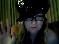 Blonde Teen Plays With Her Tits While Wearing A Policeman Cap
