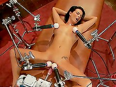 Busty Brunette Banged By Two Fucking Machines