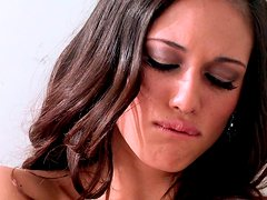 Sextractive brunette teases her shaved muf with feathers