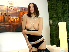 Luxurious brunette diva Cloee pokes her ass with huge dildo