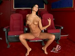 Horny bitch Angelica Heart masturbates in a cinema hall
