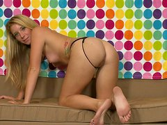 Blonde with small tits Sarah Jackson rubs her wet pussy on the sofa