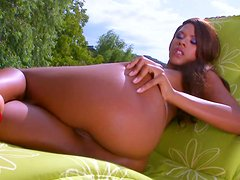 Voracious clown face Keisha Kane tickles her fancy on the deck chair