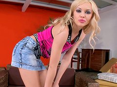 Wondrous wanker Logan stimulates her clit on the couch