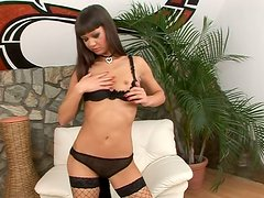 Angelina Crow in black net stockings plaing with dildo