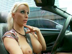 Busty blonde cougar Holly Halston flashes her boobies while driving a car