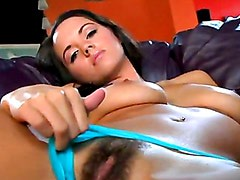 Horny Hottie Tabitha Tan Rubbing Her Hairy Snatch On The Couch Until She Cums