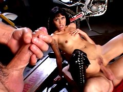 Chick in leather high boots Dana Vespoli pleases two dicks on a bike