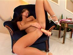 Busty hooker Ivette Blanche penetrates herself with huge plastic stick