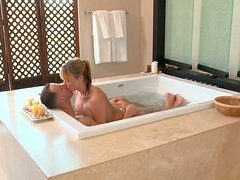 Busty blonde whore Maya Hill sucks the cock in the bath and makes a nuru massage