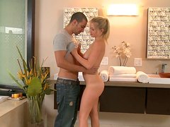Smiling blond chick Casi James is a sexy masseuse