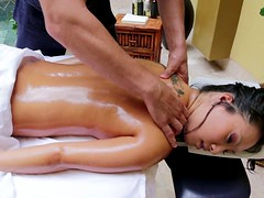 Naked oil covered Asa Akira experiences a hot erotic massage