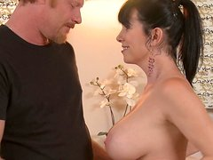 Seductive brunette MILF Rayveness works on cock with her both hands