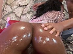 Hot ebony Megan Pryce gets her big butt oiled