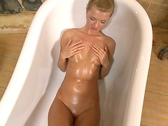 Delicious blonde chick taking sexy bath and shows her weird tits