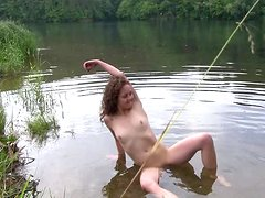 Christina is naked by the river
