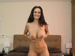 Cute mature woman Ava Adams undresses her yellow dress and shows us her big boobs with