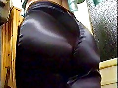 Sexy girl shows her tits in black satin pants