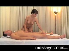 Sweet brunette with big boobs has wild sex in a massage room
