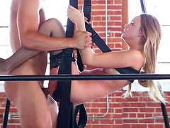 Hanged-on blonde being fucked in trimmed puss
