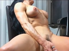 Body builder toys her rock hard fur pie