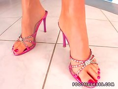 Lovely Ivette Blanche Playing with a Huge Dildo Between Her Feet
