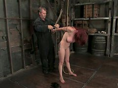 Redhead lust gets hogtied and hanged up