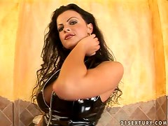 Juditta the brunette in leather corset toys her pussy