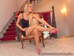 Sophie Moone moans sweetly while rubbing her clit with a toy