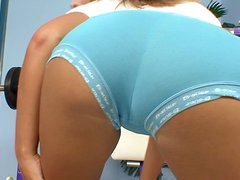Charming chick Cherie finger-fucks her awesome pussy in a gym