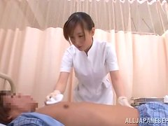 Japanese nurse gives a handjob to some guy in a hospital ward