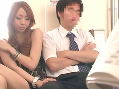 Cute Japanese girl gives a blowjob in a subway train