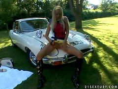 Retro car loving chick plays with her sexy pussy