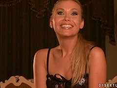 Blonde milf Michelle gives an interview in the living room