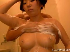Bath tub passion with a busty Japanese honey