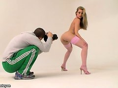 Sophie Moone the hot blonde in pink stockings poses on cam