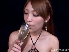A red haired Japanese bimbo enjoys two of her colleagues