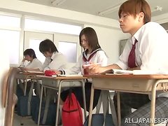 An Asian schoolgirl has her hairy haven played with
