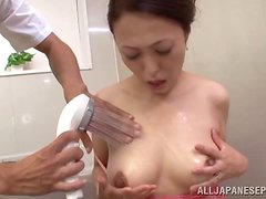A curvy MILF is showering when her son comes in..
