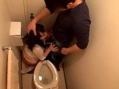 Pretty Japanese milf gets her vag touched and pounded in a toilet