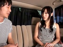 Cute Japanese teen gets her pussy fingered in a car