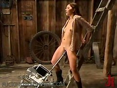 Sexy babe in cowgirl dress get fucked by sex machine in a shed