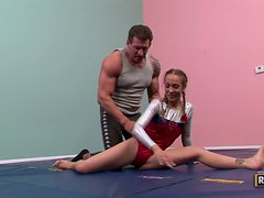 A coach fucks his flexible student Jamie Elle in the gym