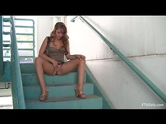 Ella masturbates on the stairs at the parking in a very sexy dress